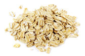 Pile of uncooked rolled oats — Stock Photo