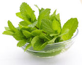 Mint sprigs in bowl — Stock Photo