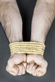 Wrists tied with rope — Stock Photo