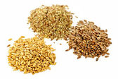 Brown, golden and ground flax seed — Stock Photo