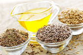 Flax seeds and linseed oil — Stock Photo