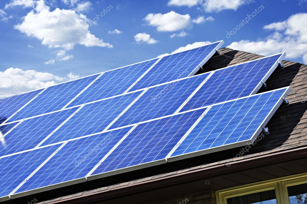 Array of alternative energy photovoltaic solar panels on roof — Stock Photo #4465217
