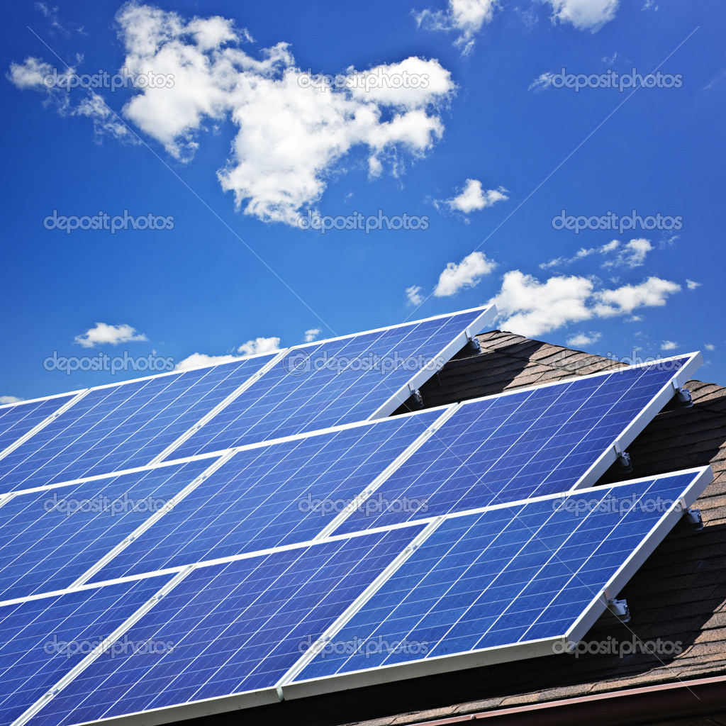 Array of alternative energy photovoltaic solar panels on roof — Stok fotoğraf #4465229