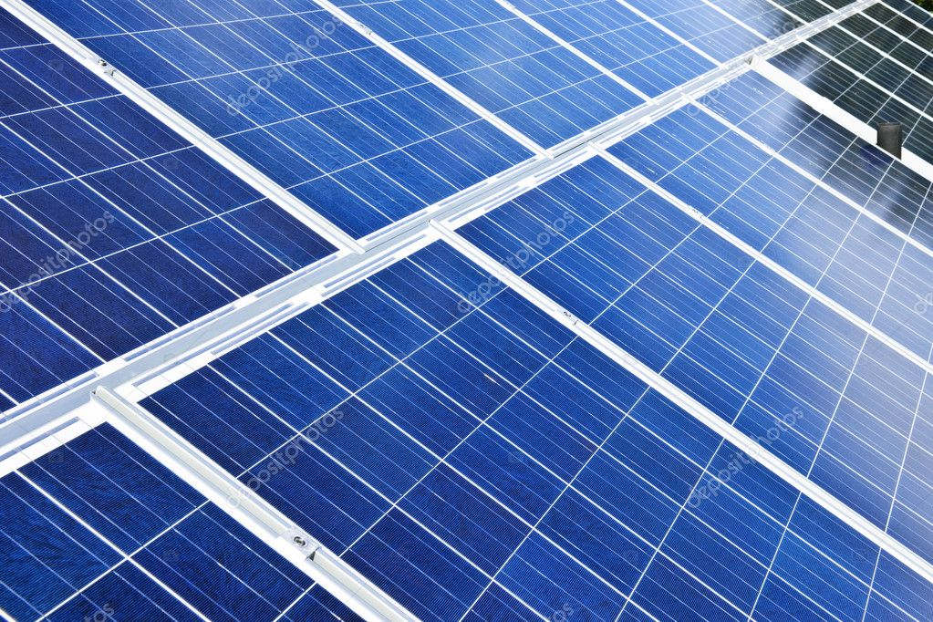 Array of alternative energy photovoltaic solar panels — Stock Photo #4465243
