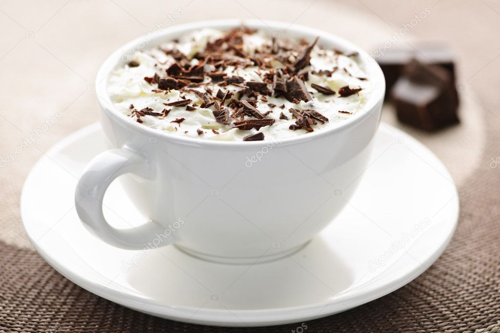 Cup of hot cocoa with shaved chocolate and whipped cream — Stock Photo #4466399