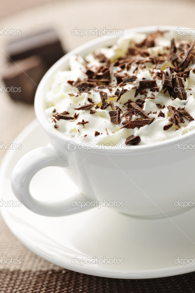 Cup of hot cocoa with shaved chocolate and whipped cream  Stock Photo #4466414