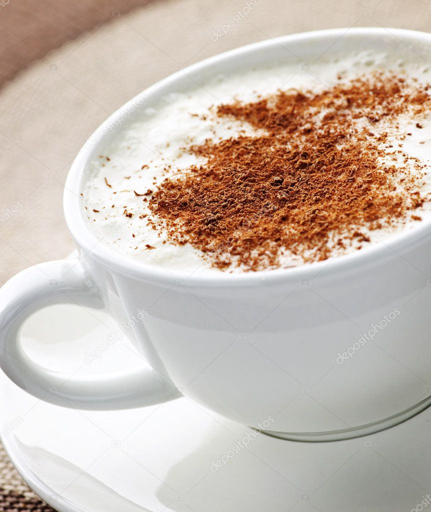 Cappuccino or latte coffee in cup with frothed milk and cookies — Stok fotoğraf #4466448