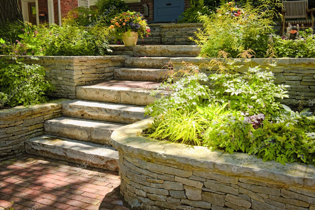 Natural stone landscaping in home garden with stairs — Stock Photo #4467602
