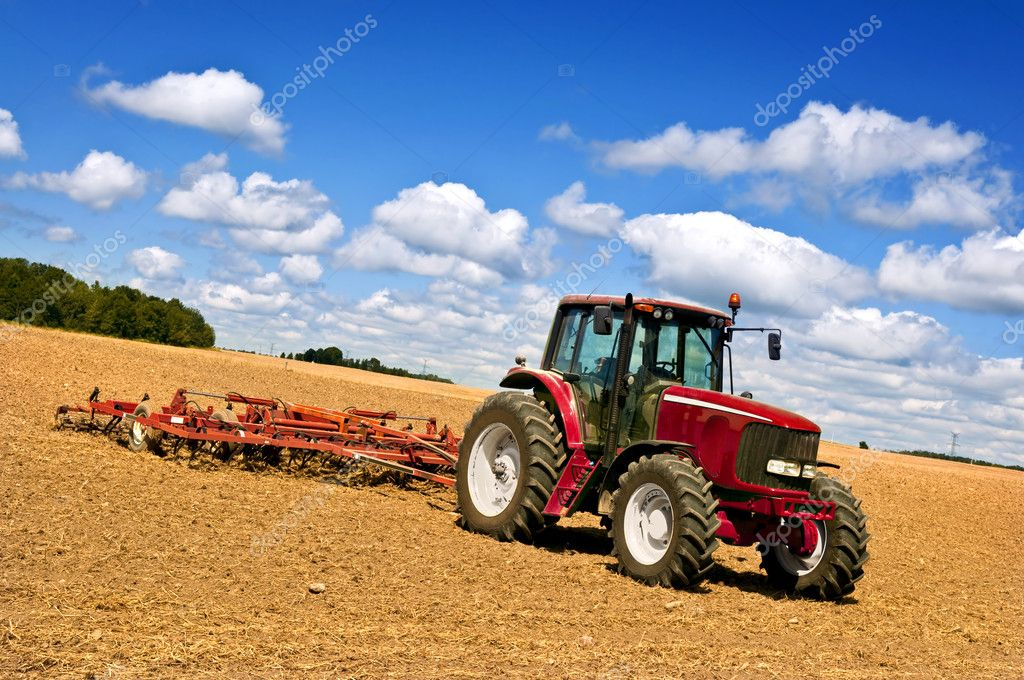 Small scale farming with tractor and plow in field — Stock Photo #4468455