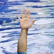 Stock Photo: Hand of drowning man