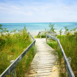 Wooden walkway over dunes at beach — Stock Photo