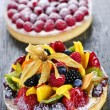 Fruit and berry tarts - Stock Photo