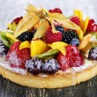 Stock Photo: Mixed tropical fruit tart
