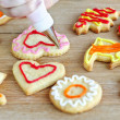 Stock Photo: Decorating cookies