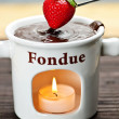 Strawberry dipped in chocolate fondue — Stok fotoğraf
