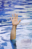 Hand of drowning man — Stock Photo