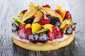 Mixed tropical fruit tart — Stock Photo