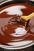 Melted chocolate and spoon — Stock Photo