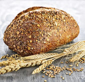 Loaf of multigrain bread — Stock Photo