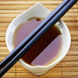 Soy sauce with chopsticks - Stock Photo