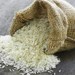 Stock Photo: Long grain rice in burlap sack