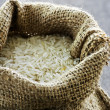 Long grain rice in burlap sack — Stock Photo #4482327