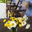 Wildflowers bouquet at cottage - Stock Photo