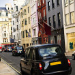 Royalty-Free Stock Photo: London taxi on shopping street