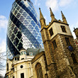 Gherkin building and church of St. Andrew Undershaft in London — Stock Photo #4483025