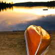 Stock Photo: Lake sunset with canoe on beach