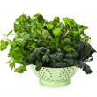 Dark green leafy vegetables in colander — Stock Photo