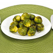 Plate of brussels sprouts - Stock Photo