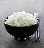 Rice bowl with chopsticks — Stock Photo