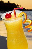 Tropical orange drink — Stock Photo
