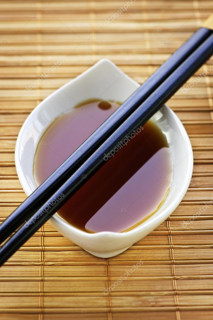 Close up of chopsticks on white soy sauce dish — Stock Photo #4482302