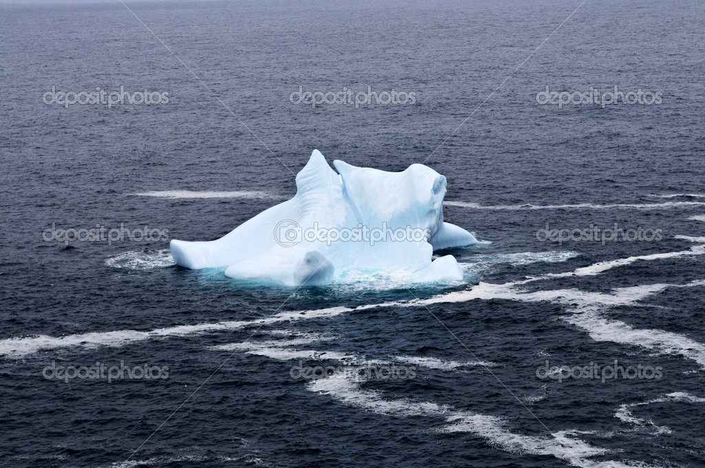 Melting iceberg off the coast of Newfoundland, Canada — Stock Photo #4482713