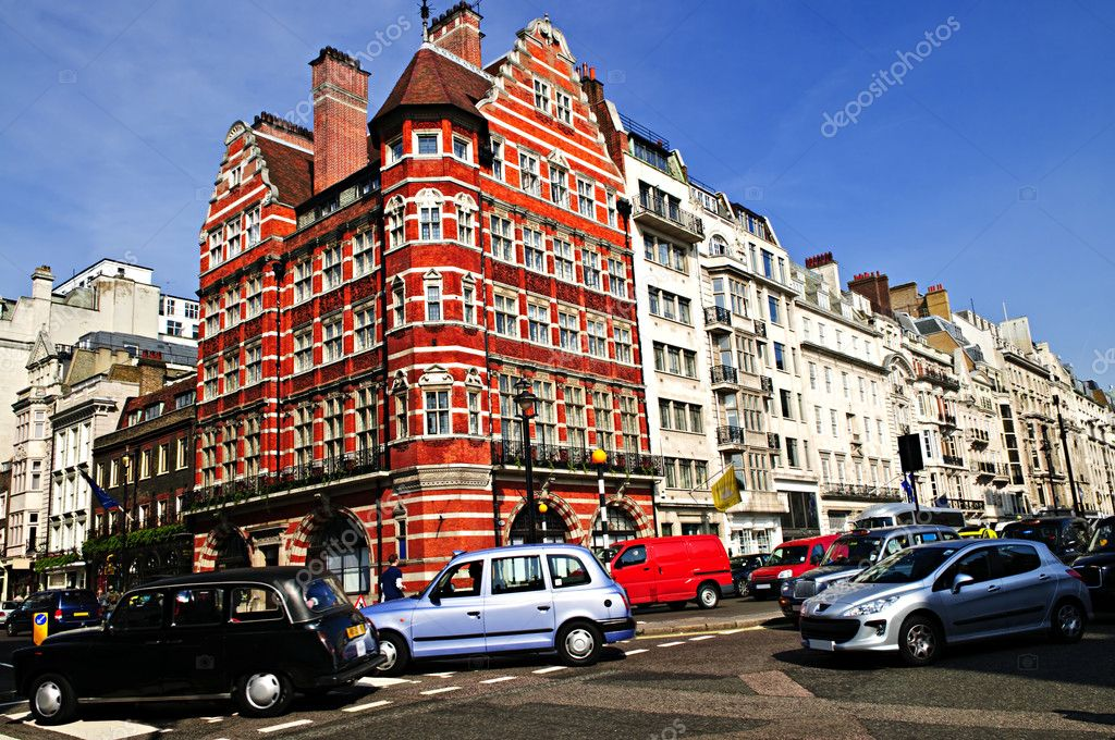 London taxi on busy street corner in England — Stock Photo #4482898