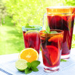 Fruit punch in pitcher and glasses - Foto de Stock