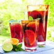 Fruit punch in pitcher and glasses - Stock Photo