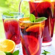 Fruit punch in pitcher and glasses — Stock Photo #4494261