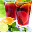 Fruit punch in glasses - Stock Photo