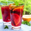 Fruit punch in glasses — Stock Photo