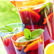 Fruit punch in pitcher and glasses — Stock Photo #4494281