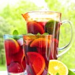 Fruit punch in pitcher and glasses — Stock Photo #4494286