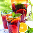 Fruit punch in pitcher and glasses — Stock Photo #4494294