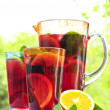 Fruit punch in pitcher and glasses — Stock Photo #4494295