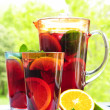 Fruit punch in pitcher and glasses — Stock Photo #4494296