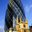 Gherkin building and church of St. Andrew Undershaft in London — Stock Photo #4494693