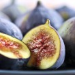 Plate of sliced figs - Stock Photo