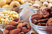 Bowls of assorted nuts — Stock Photo